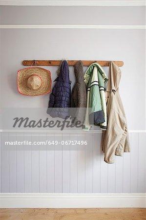 Coats and hat on coat rack