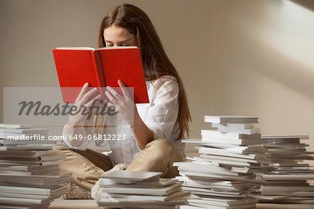 Girl sitting on floor reading book