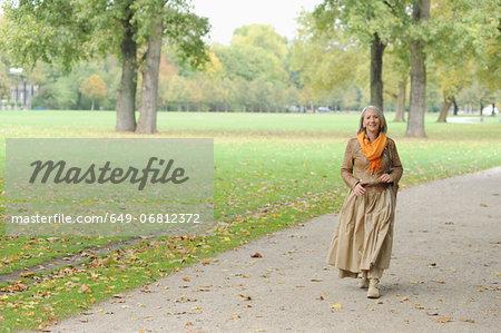 Senior woman walking in park