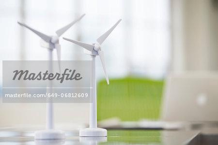 Two models of wind turbines on desk