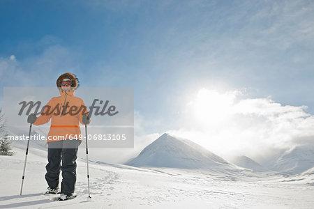 Woman wearing snow shoes, Skidadalur, Dalvik, Iceland