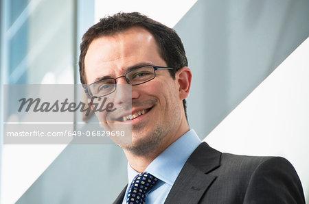 Portrait of male office worker wearing glasses
