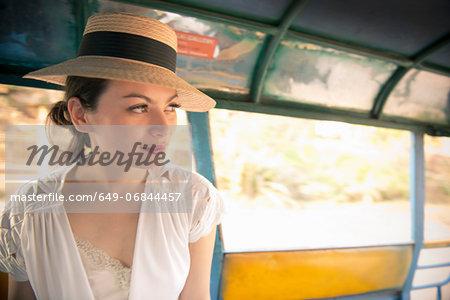 Woman wearing hat on rickshaw
