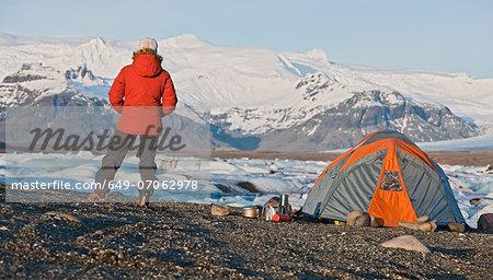 Woman by tent at glacier lake Jokulsa Loni Iceland - Stock Photo & Woman by tent at glacier lake Jokulsa Loni Iceland - Stock Photo ...