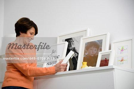 Senior woman looking at family photographs