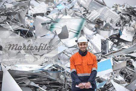 Portrait of worker in front of scrap aluminum