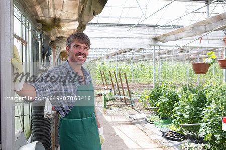 Portrait of organic farmer in greenhouse