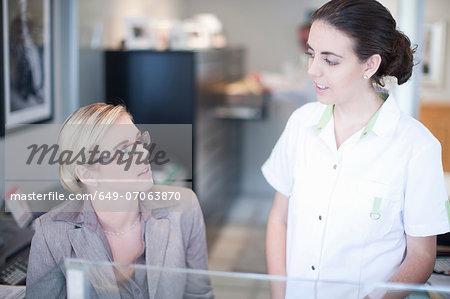Nurse talking to hospital receptionist