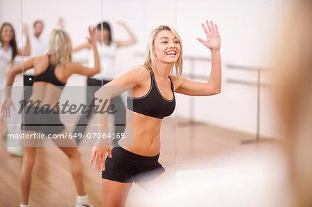 Young woman enjoying aerobics class