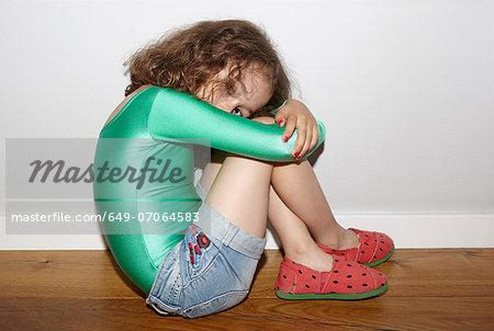 Child on floor in fetal position