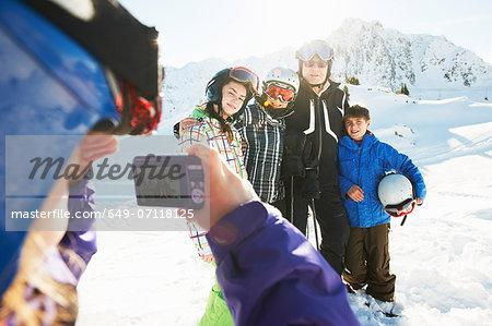 Girl photographing family, Les Arcs, Haute-Savoie, France
