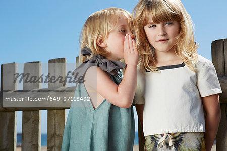 Girls sharing secret
