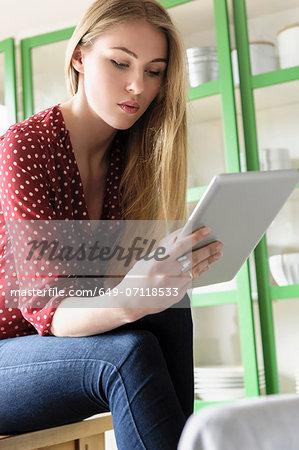 Girl looking at digital tablet