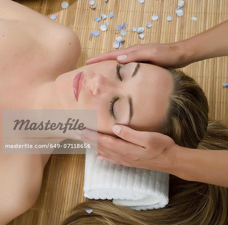 Close up of woman having head massage