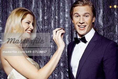 Young woman feeding chocolate to boyfriend