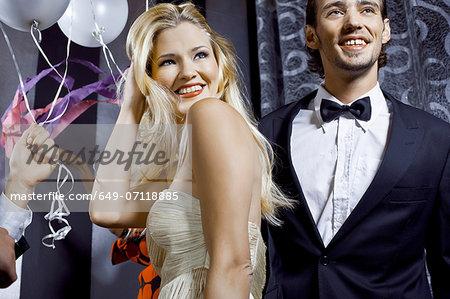 Young couple having fun in nightclub