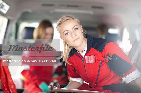 Portrait of paramedics in ambulance