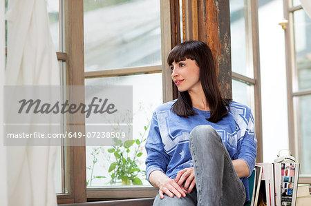 Woman on windowsill