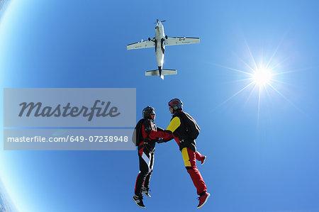 Female skydivers free falling above Leutkirch, Bavaria, Germany