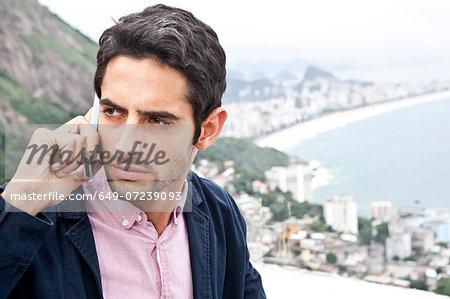 Young man on mobile, Casa Alto Vidigal, Rio De Janeiro, Brazil