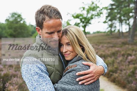 Mid adult couple hugging