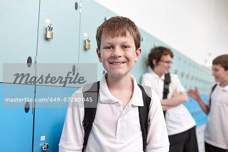 Portrait of schoolboy in corridor