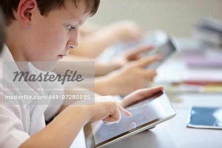 Close up of schoolchildren working in class