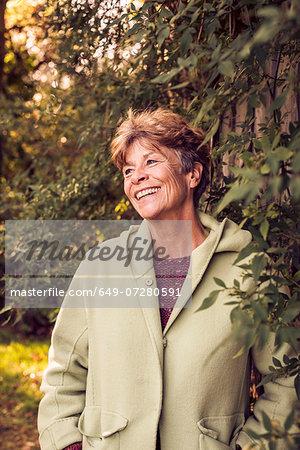 Portrait of mature woman in garden