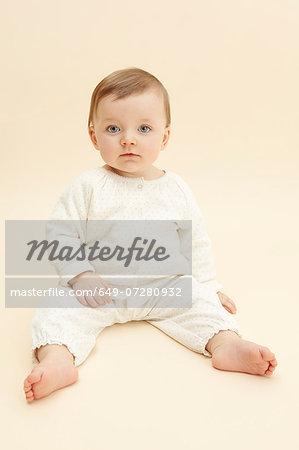 Studio portrait of baby girl staring at camera