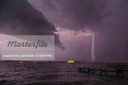 View of storm and lightning on Lake Starnberg, Bavaria, Germany