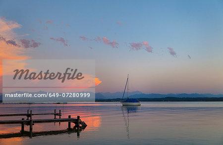 View of yacht at sunset on Lake Starnberg, Bavaria, Germany