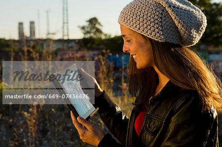 Young woman looking at digital tablet screen