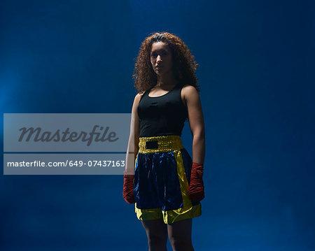 Studio portrait of female boxer in hand bandages