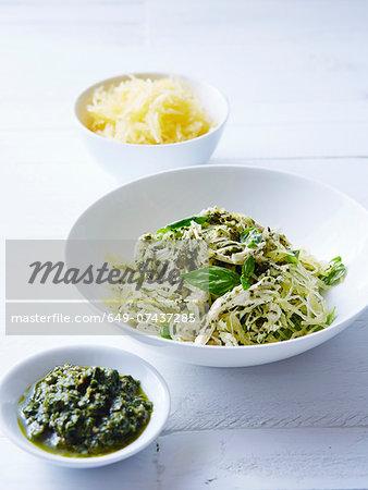 Still life of vegetable spaghetti with chicken pesto