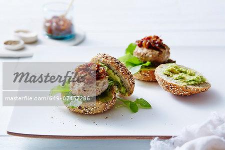 Still life of chicken and avocado burgers