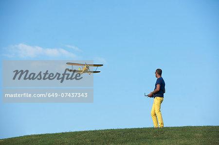 Man flying model plane