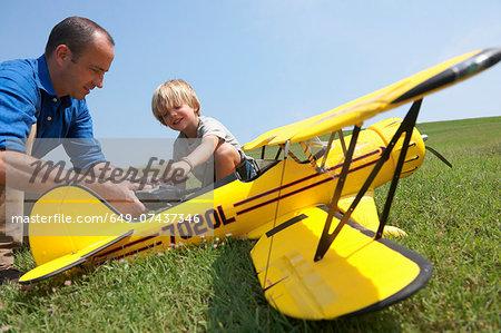 Father and son preparing model plane