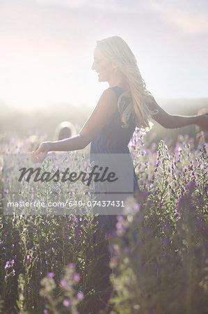 Girl dancing on meadow