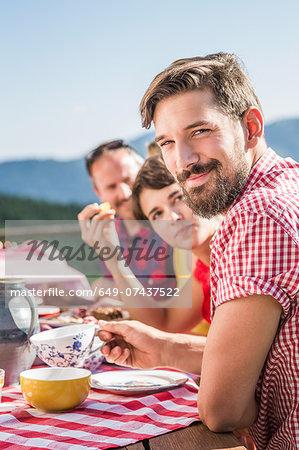 Friends enjoying breakfast outside, Tyrol, Austria