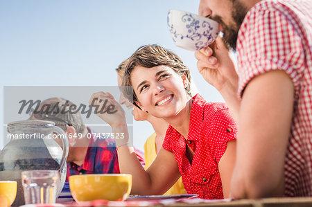 Group of friends enjoying breakfast outdoors
