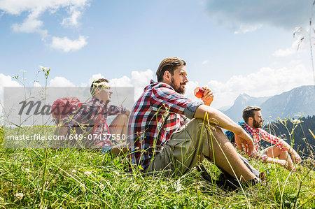 Male friends resting on hike, Tyrol, Austria