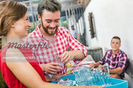Young man flirting with waitress, Tyrol, Austria