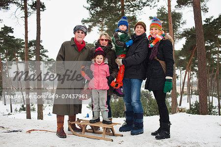 Family portrait of three generations in winter scene