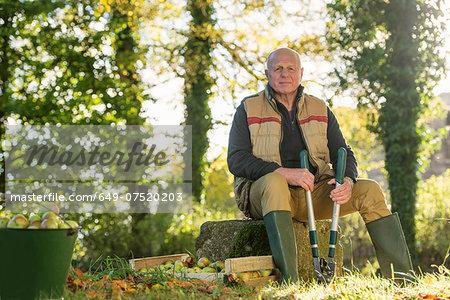 Portrait of senior man holding pruner