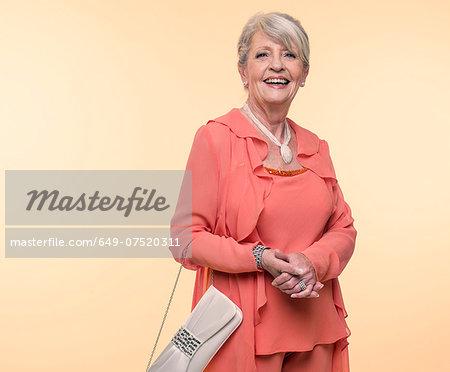 Studio portrait of elegant senior woman