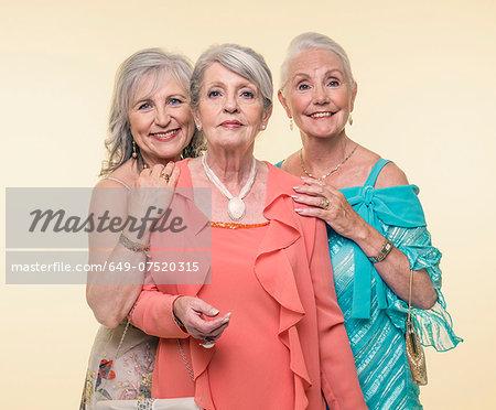 Studio portrait of three glamorous senior women