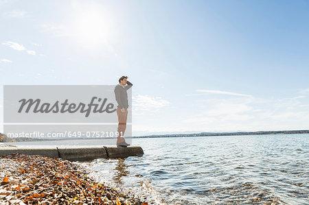 Man on jetty, Lake Starnberg, Bavaria, Germany