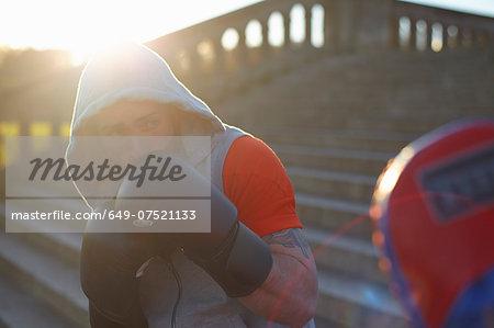 Young man boxing training