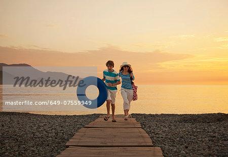 Mother and teenage son on boardwalk, Fethiye, Turkey