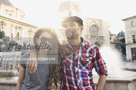 Tourist couple posing, Plaza de la Virgen, Valencia, Spain